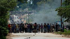 Zimbabwean protesters burn tires, block roads over fuel price hike