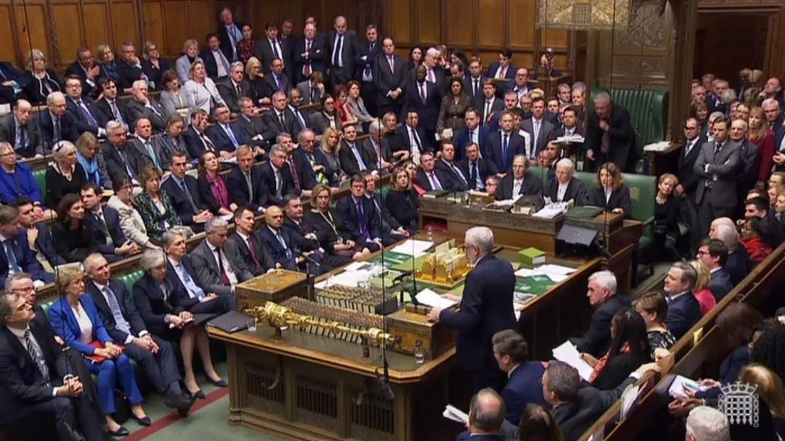 Britain's main opposition Labour Party leader Jeremy Corbyn (R) standing to give his response and to table a motion of no confidence in the Government in the House of Commons after MPs rejected the government's Brexit deal. (AFP)