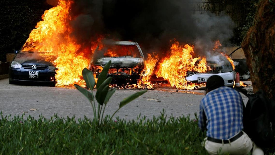 Cars are seen on fire at the scene of explosions and gunshots in Nairobi, Kenya. (Reuters)