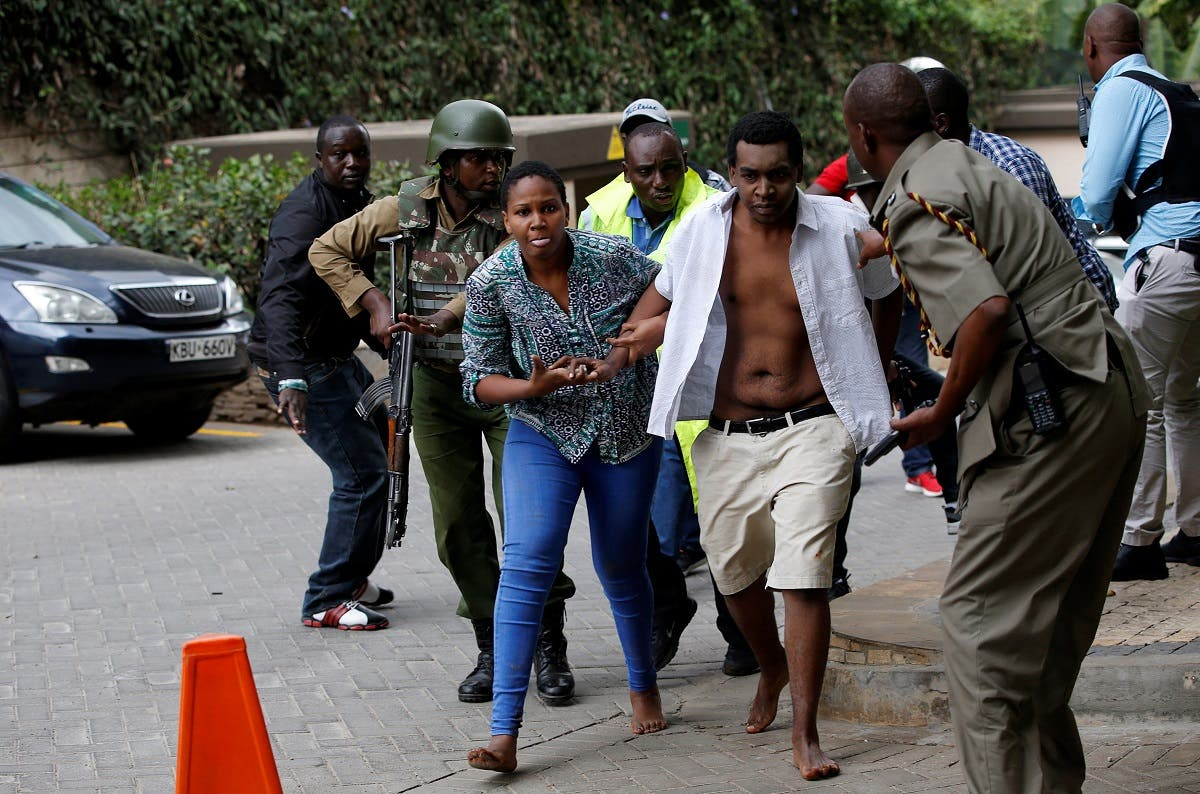People are evacuated at the scene where explosions and gunshots were heard at the Dusit hotel compound in Nairobi. (Reuters)