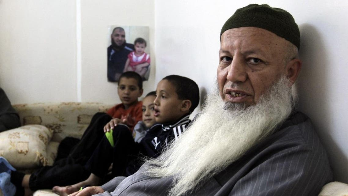 Top Salafist leader in Jordan, Abed Shehadeh, known as Abu Mohammad Tahawi, and father-in-law of Jordanian of Palestinian origin Salafist, Mahmud Abdelal, who blew himself up in the Syrian city of Daraa last month, sits with his grandsons in the Baqaa Palestinian refugee camp, north of Amman, on November 1, 2012. Tahawi said more than 250 Jordanian jihadists are now in Syria to fight and that 13 others have been killed there. AFP PHOTO/KHALIL MAZRAAWI KHALIL MAZRAAWI / AFP