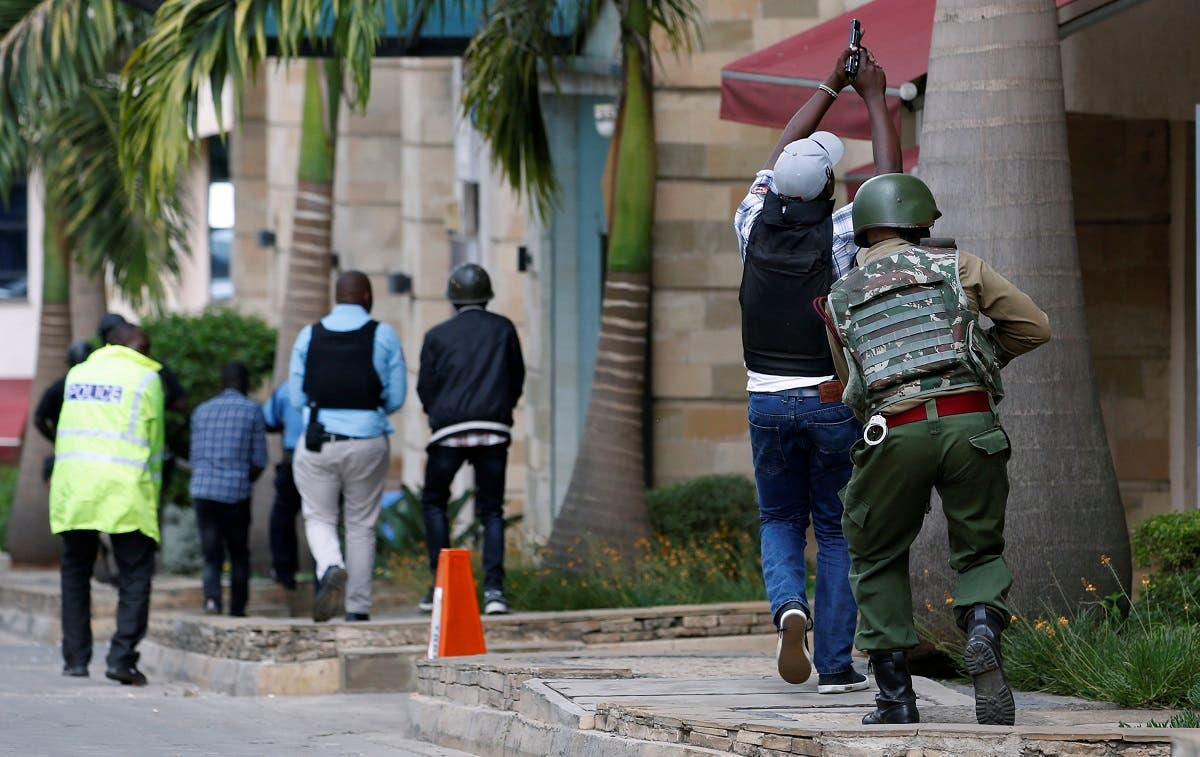 Members of security forces are seen at the scene where explosions and gunshots were heard at the Dusit hotel compound, in Nairobi. (Reuters)