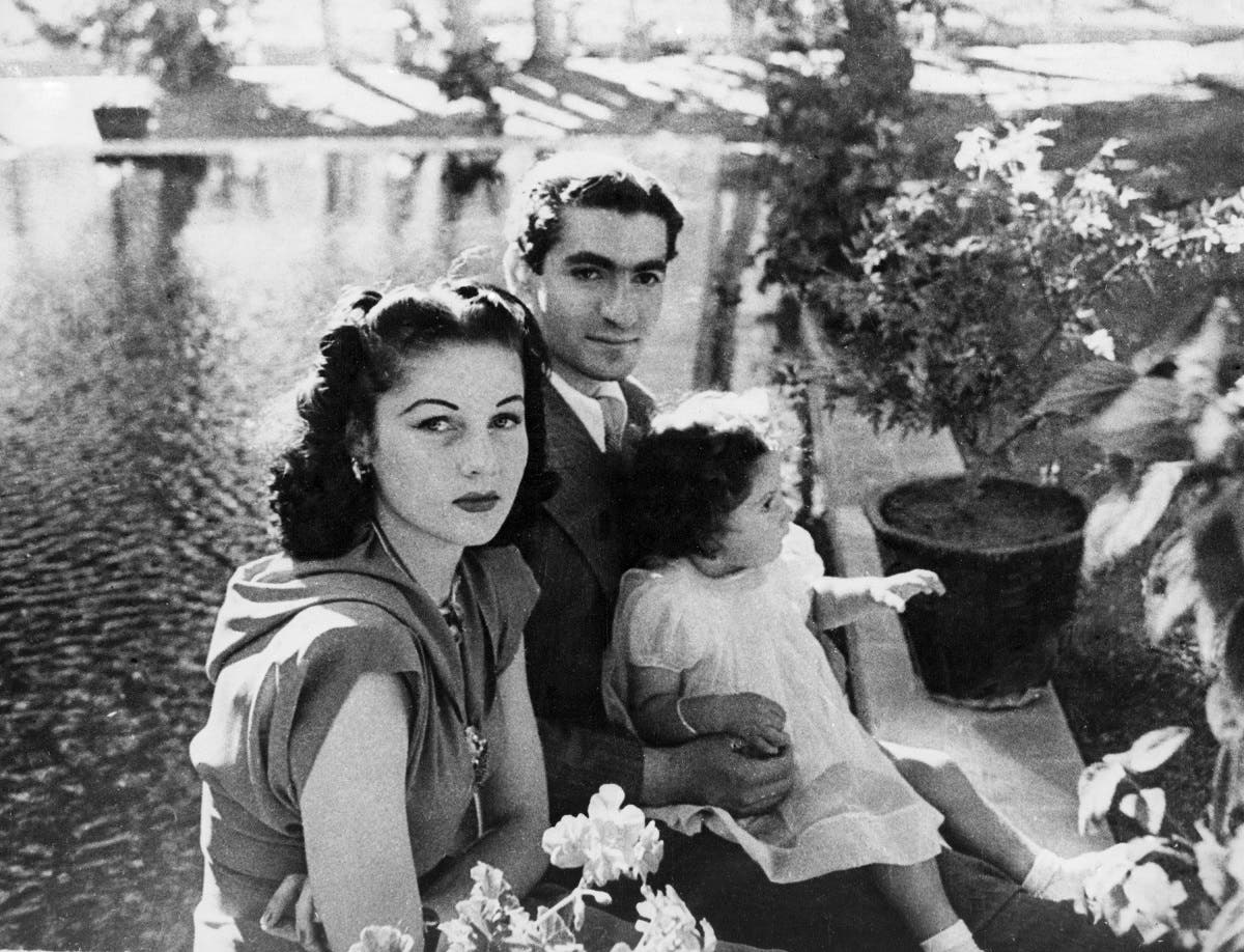In this undated 1942 file photo, Reza Pahlavi, his wife, Queen Fawzia and Princess Shahnaz on the grounds of their palace near Tehran. (AP)