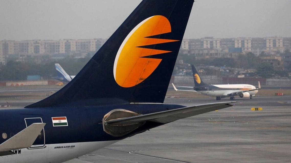 A Jet Airways plane is parked as another moves to the runway at the Chhatrapati Shivaji International airport in Mumbai, India. (Reuters)