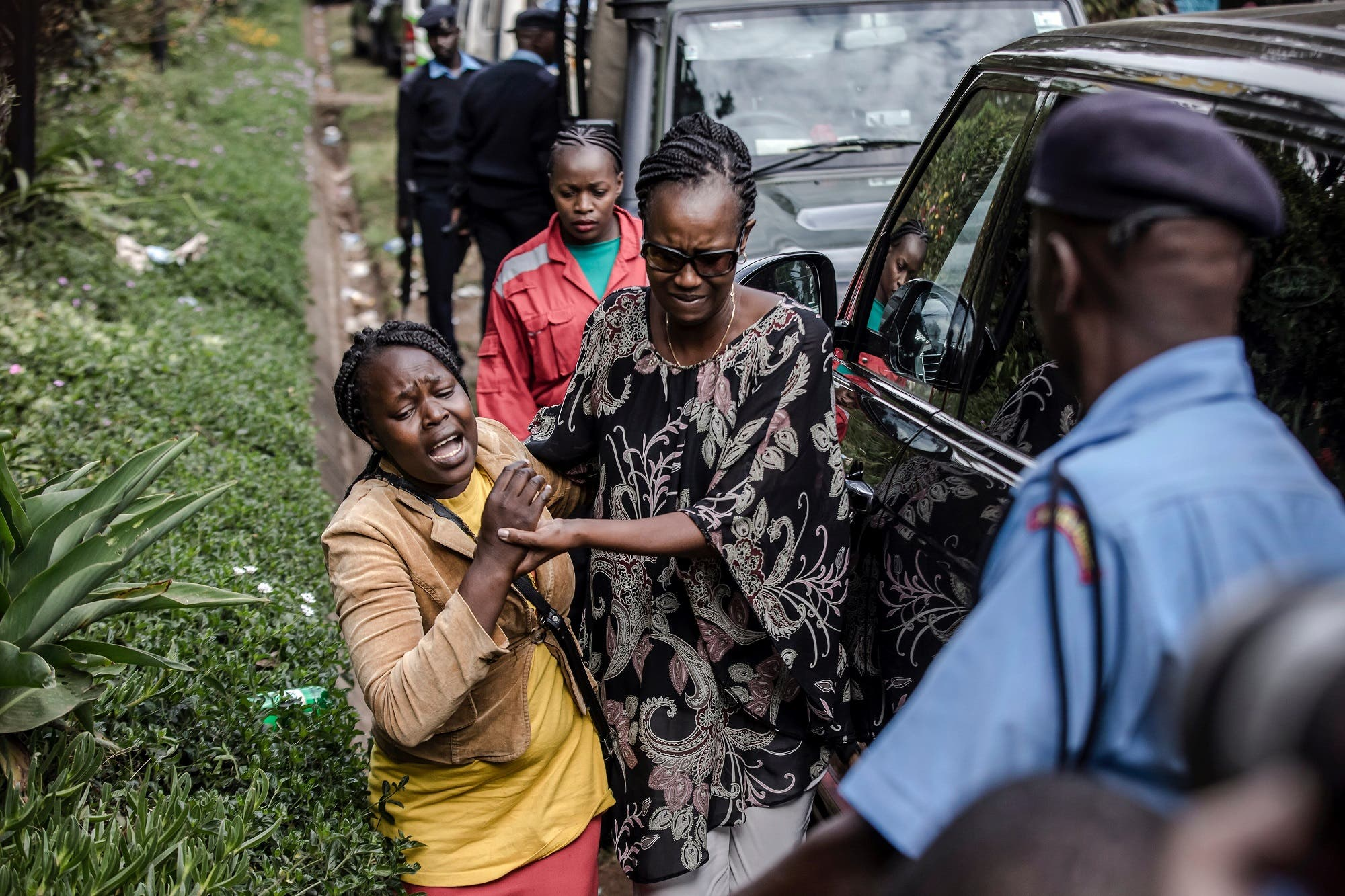 A woman is rescued at the scene of an on going terrorist attack at a hotel complex in Nairobi (AFP)