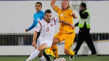 Australia stun Syrians with late goal to book spot in last 16
