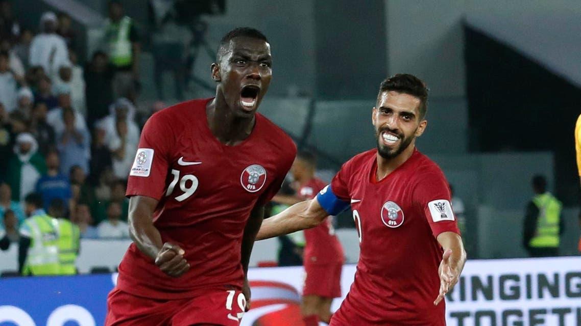 qatar celebrate goal ap