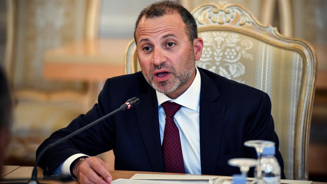 Lebanese Foreign Minister Gebran Bassil talks to his Russian counterpart during their meeting in Moscow, on August 20, 2018