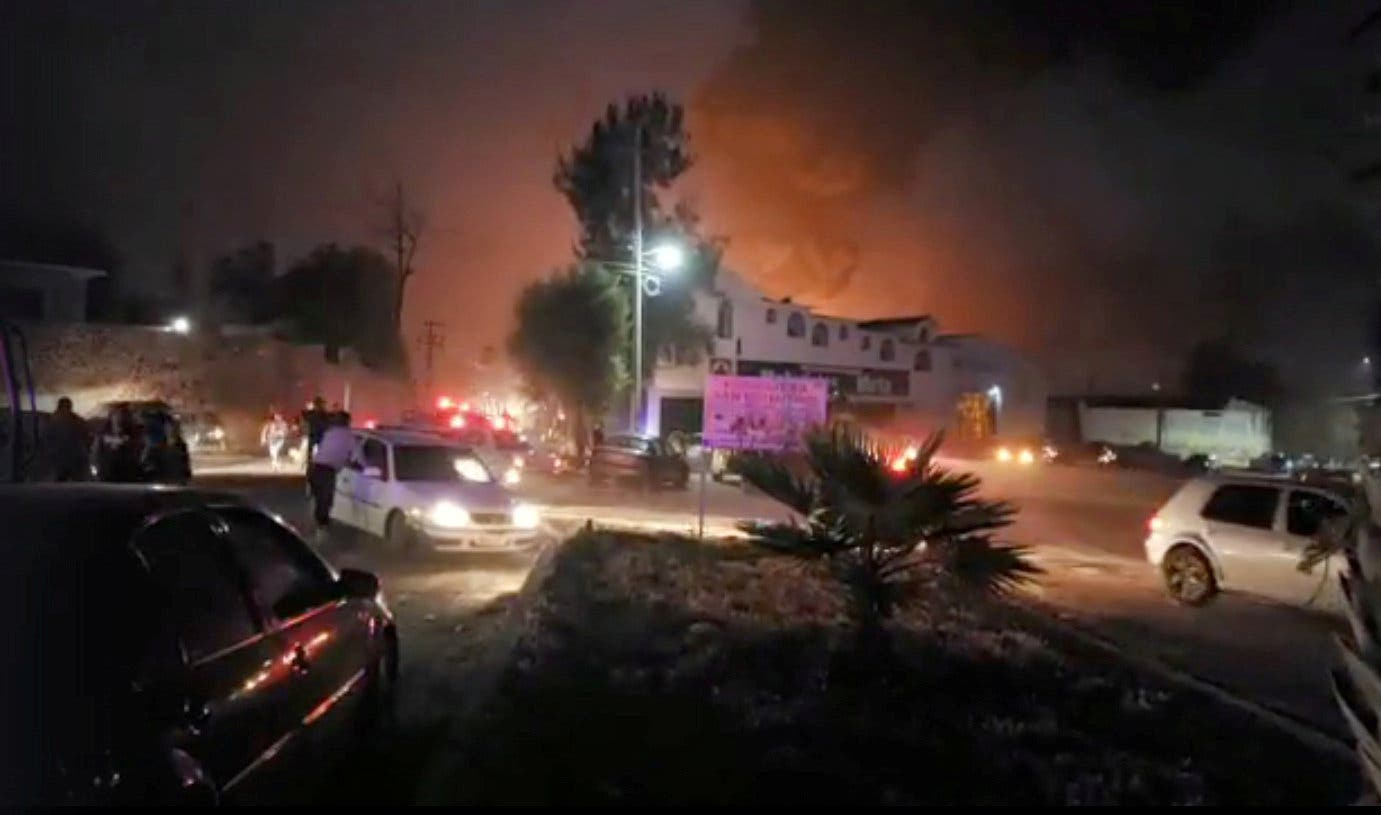 People react at the scene where a ruptured fuel pipeline exploded, in the municipality of Tlahuelilpan, Hidalgo. (Reuters)