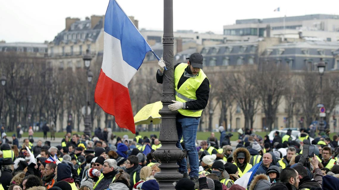 """Yellow Vest"" demonstrators gathered in the French capital on Saturday for their tenth consecutive weekend of protests against President Emmanuel Macron's government. (Reuters)"