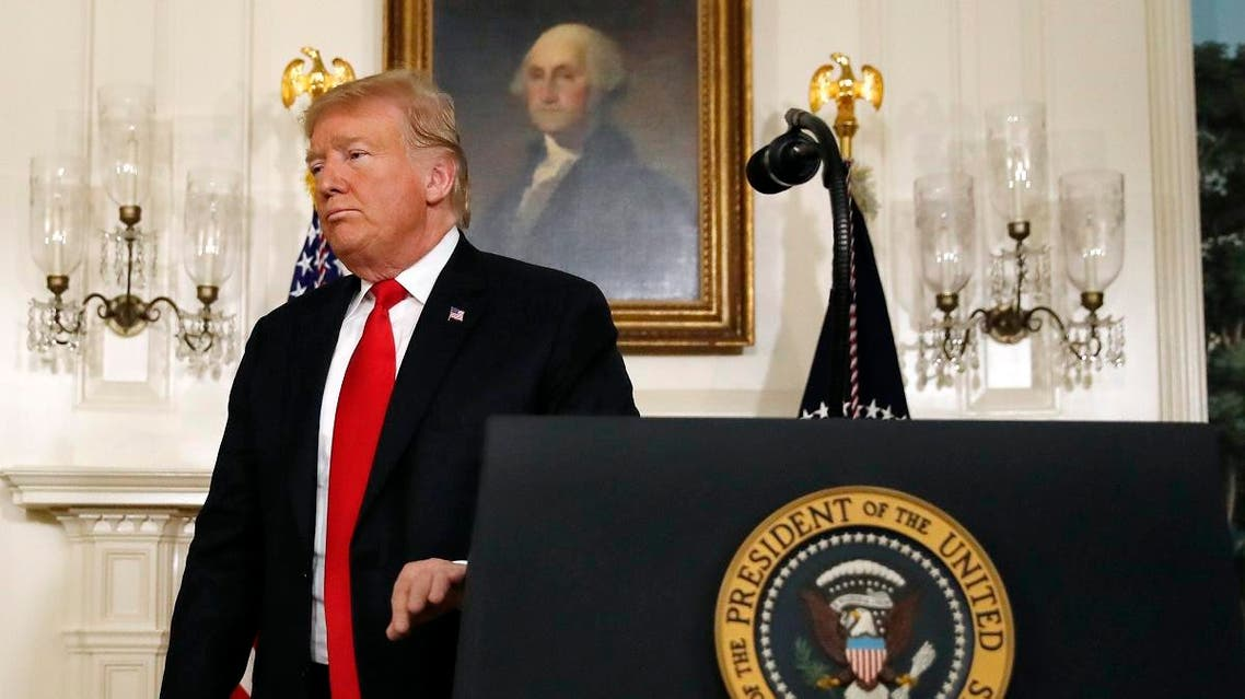 President Donald Trump leaves the podium after speaking about the partial government shutdown, immigration and border security in the Diplomatic Reception Room of the White House, in Washington, Saturday, Jan. 19, 2019. (AP)