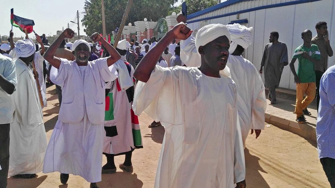 Sudanese men shout slogans during an anti-government protest following Friday noon prayers on Jan. 18. (Reuters)