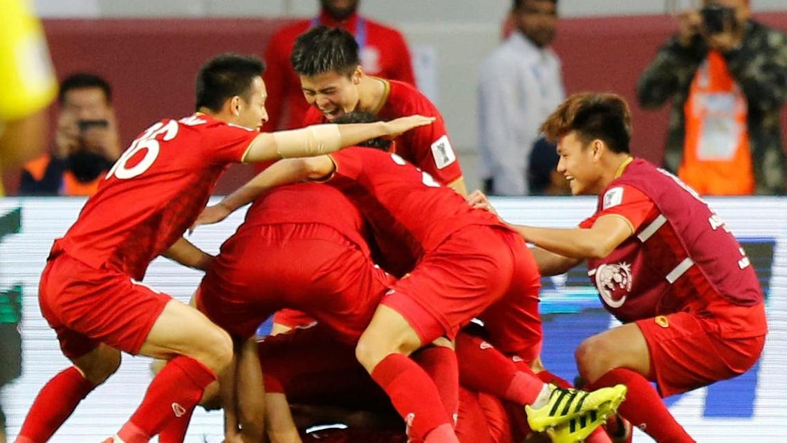 Vietnam celebrate victory after defeating Jordan on penalties in the last 16 of the Asian Cup. (Reuters)