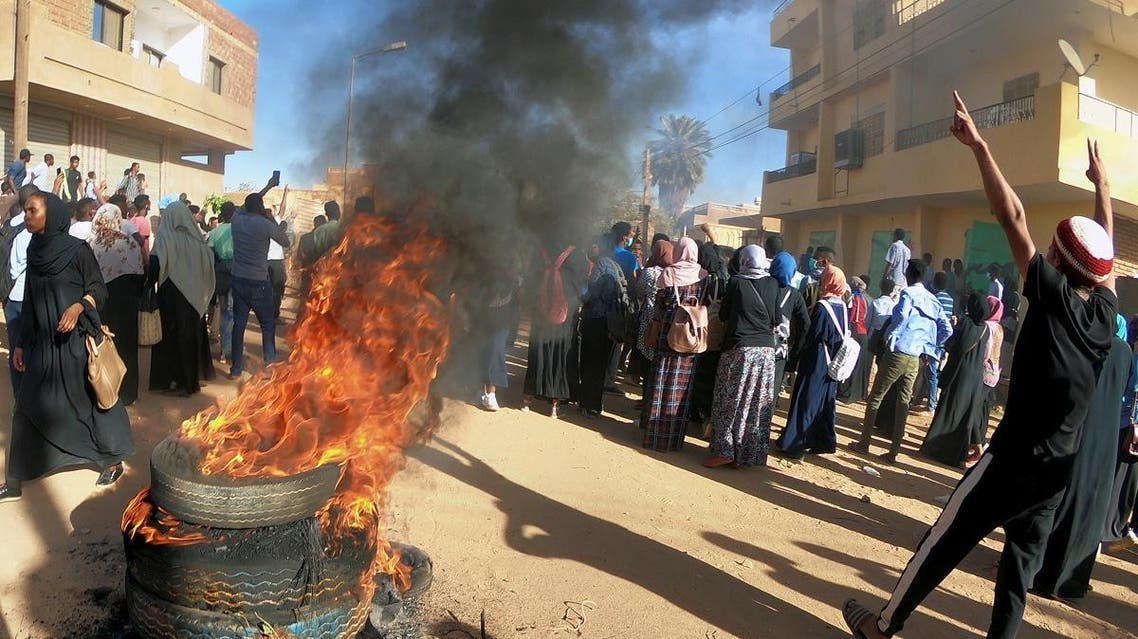 Sudanese demonstrators burn tyres as they participate in anti-government protests in Omdurman, Khartoum. (Reuters)