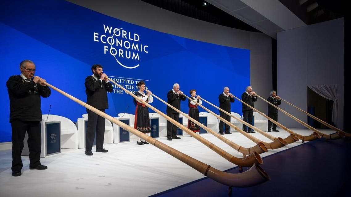 Alphorn blowers perform during the opening of the World Economic Forum (WEF) annual meeting, on January 22, 2019 in Davos, eastern Switzerland. (AFP)