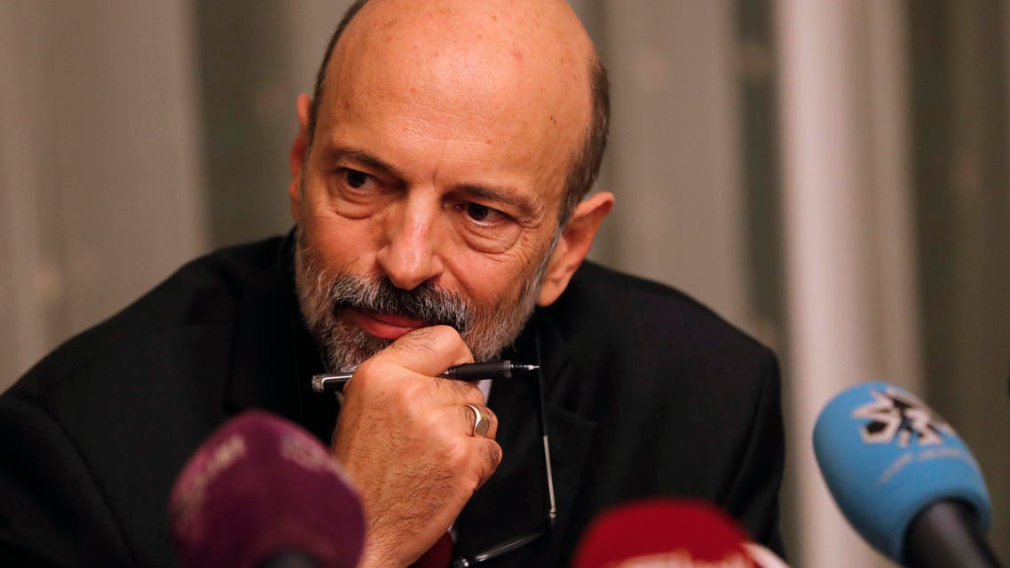 "The newly appointed Jordanian Prime Minister Omar al-Razzaz meets with member of Union leaders in Amman, on June 7, 2018. Al-Razzaz said that a deal has been reached to withdraw a proposed income tax law that has sparked a week of angry protests. ""An agreement has been found to withdraw the bill,"" Razzaz told journalists after meeting legislators, without setting a firm date for parliament to send the legislation back to the government."