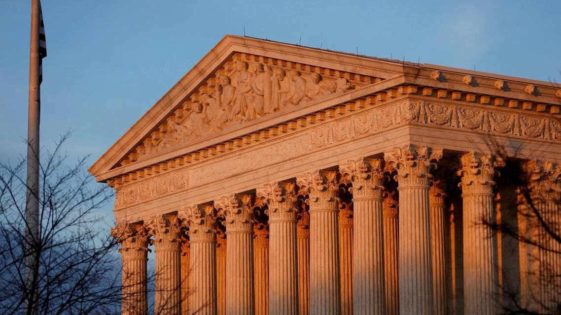 Light from the setting sun shines on the Supreme Court in Washington. (Reuters)