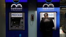 Lebanon dollar bonds slip after Moody's credit rating cut
