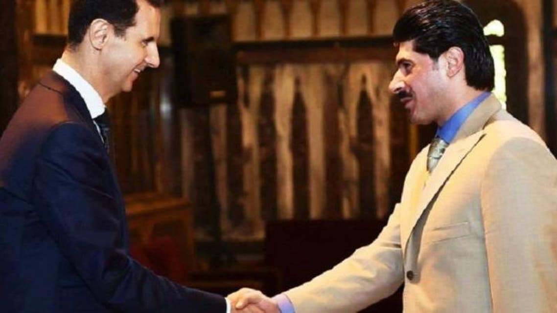 المعاقب حسام القاطرجي في صورة سابقة مع الأسد