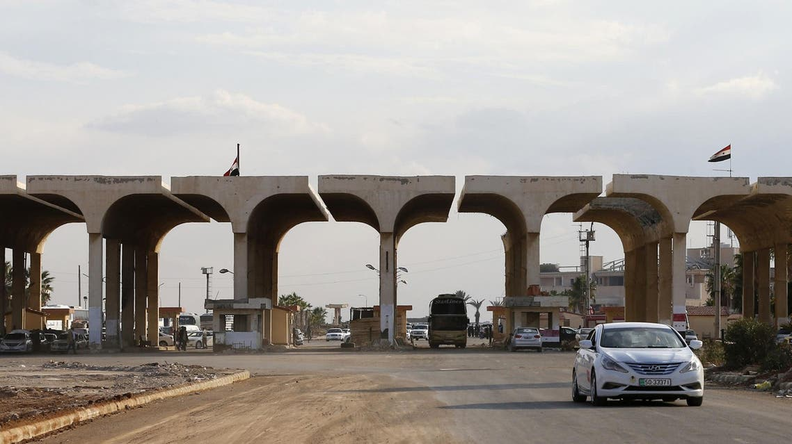 A vehicle steers it's way into Syria through the Nassib border at the Syrian-Jordanian border on November 7, 2018. (File photo: AFP)