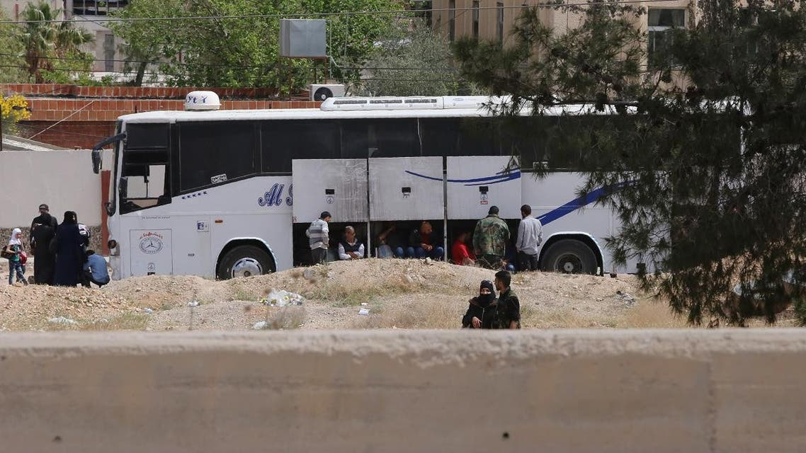 A bus carrying Jaish al-Islam fighters and their families from their former rebel bastion of Douma arrives at the Syrian government-held side of the Wafideen checkpoint on the outskirts of Damascus, after being evacuated from the last rebel-held pocket in Estearn Ghouta on April 9, 2018. (AFP)