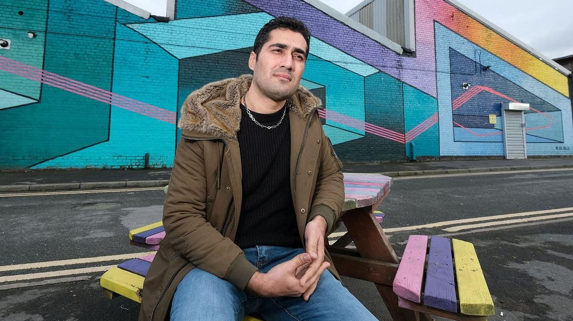 Iranian asylum seeker Fardin Gholami poses for a photograph in Liverpool. (Reuters)