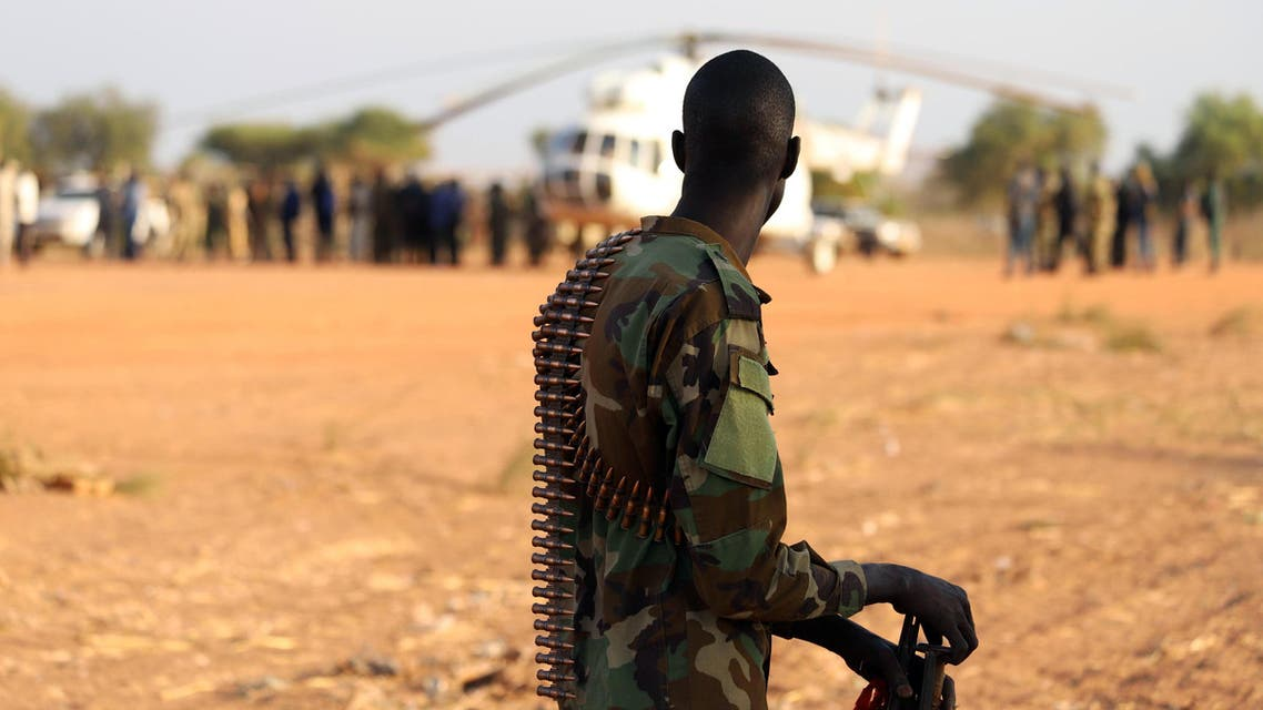 An armed member of the South Sudanese security forces during a ceremony marking the restarting of crude oil pumping at the Unity oil fields in South Sudan, on January 21, 2019. (Reuters)