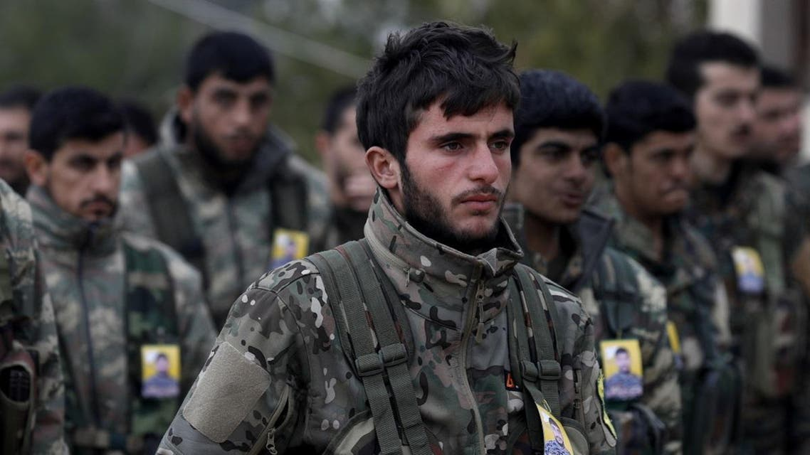 Fighters from the Syrian Democratic Forces (SDF) attend the funeral of a fellow fighter, who was killed while fighting against ISIS in the northeastern Syrian Kurdish-majority city of Qamishli on January 18, 2019. (AFP)