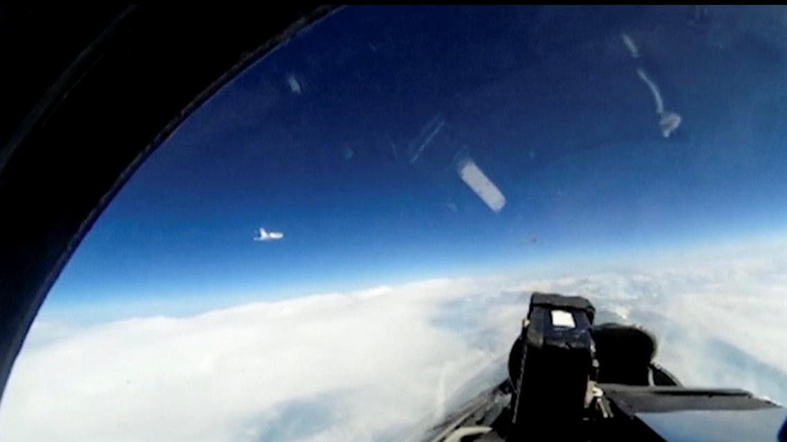 A still image taken from a video footage released by Russia's Defence Ministry shows a Russian Sukhoi Su-27 fighter jet intercepting a Swedish reconnaissance plane over the Baltic Sea