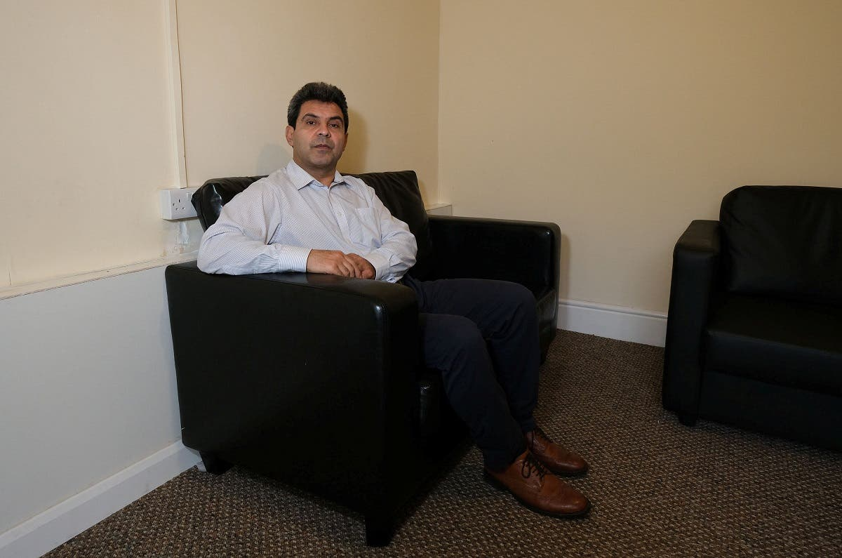 Iranian asylum seeker Mohammad Salehi Bakhtiari poses for a photograph at his home in Liverpool. (Reuters)