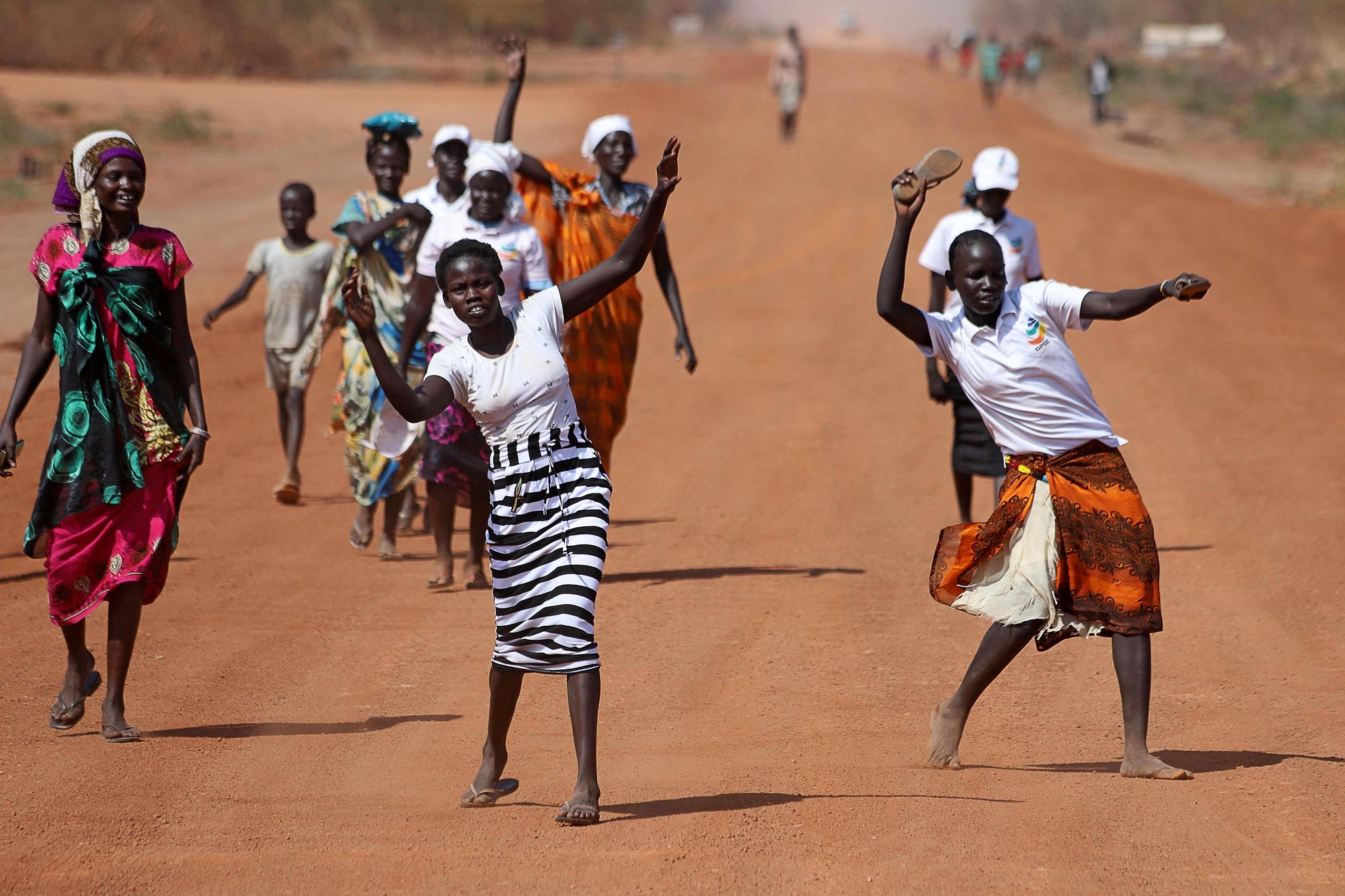 South Sudanese women dance during a ceremony marking the restarting of crude oil pumping at the Unity oil fields in South Sudan on January 21, 2019. (Reuters)