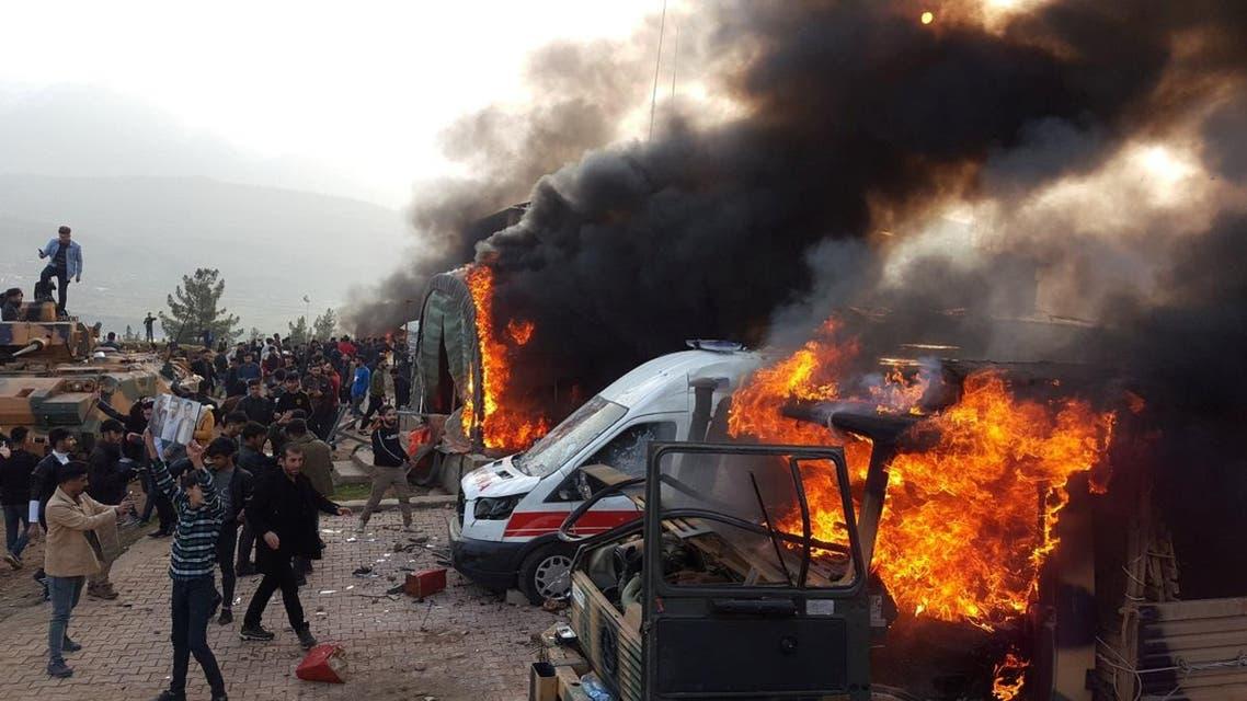 Dohuk, Iraq Turkey military camp ablaze (Reuters)