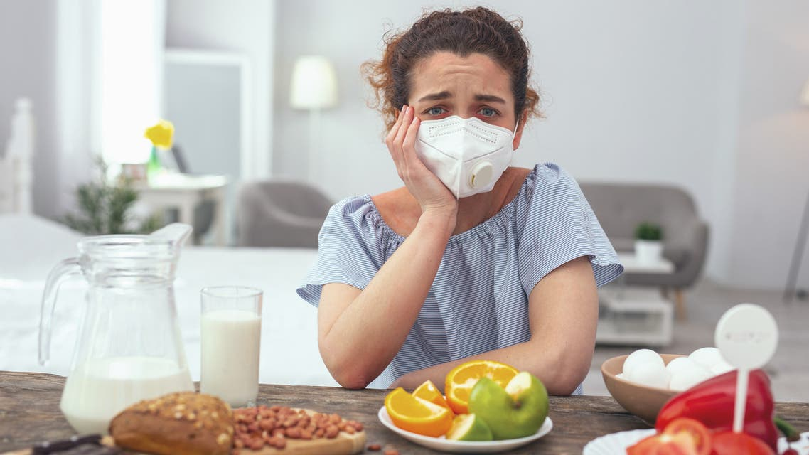 Young woman feeling upset about her multiple allergies - Stock image