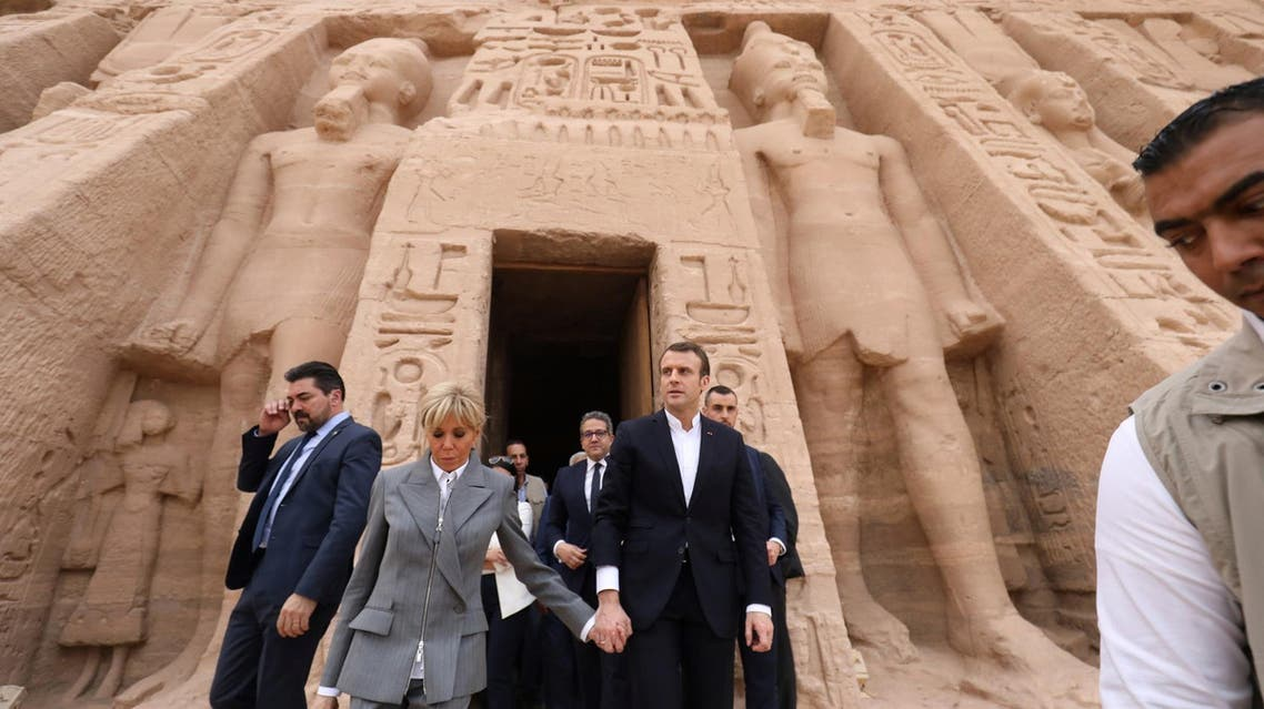 French President Emmanuel Macron arrived Sunday in Egypt with his wife Brigitte, and stopped to visit the iconic temple of Abu Simbel in the south. (AFP)