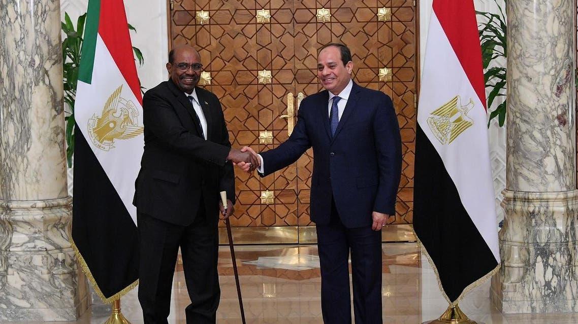 Omar al-Bashir and Abdel Fattah al-Sisi (AFP)