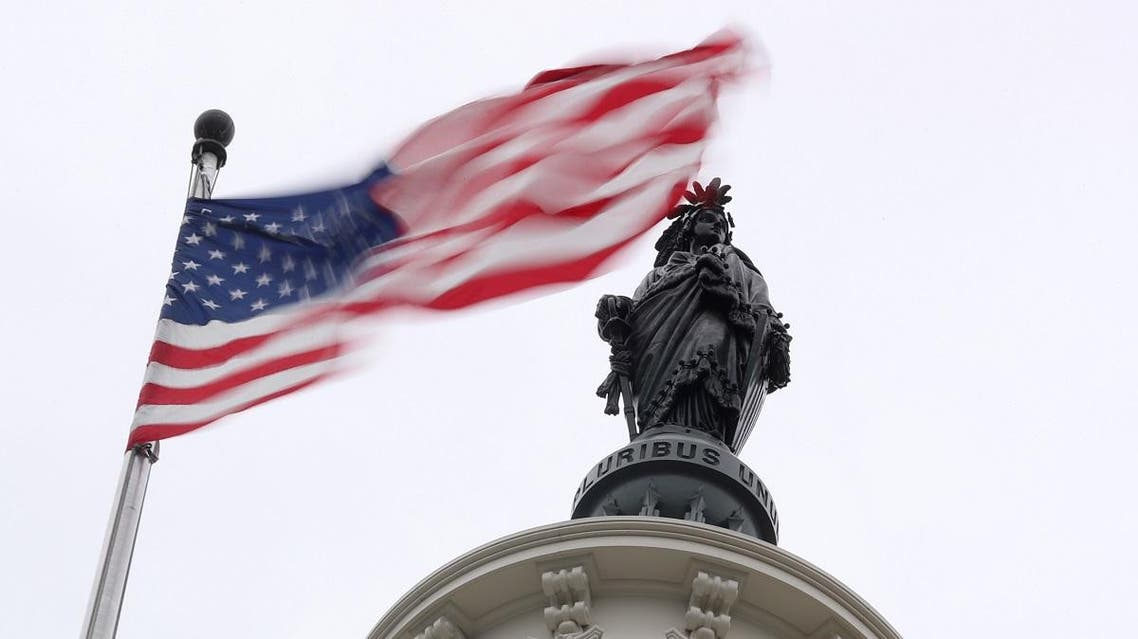 The U.S. flag flies near the Statue of Freedom atop the U.S. Capitol in Washington, U.S. November 2, 2018. REUTERS/Jonathan Ernst