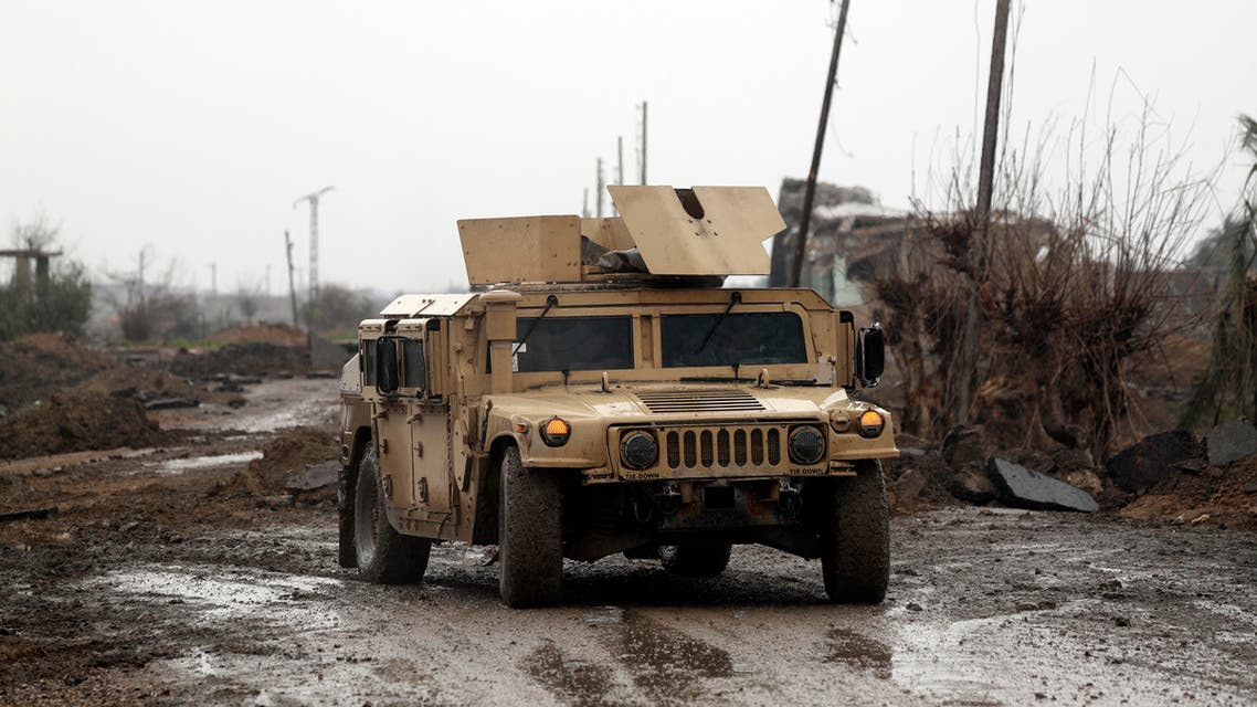 Syrian Democratic Forces (SDF) vehicles make their way on a dirt road on January 28, 2019, in the town of Sousa, in Syria's eastern province of Deir Ezzor. Kurdish-led fighters pressed their assault against the Islamic State group in eastern Syria Monday, boxing the jihadists into a tiny last pocket of land along the Euphrates River.