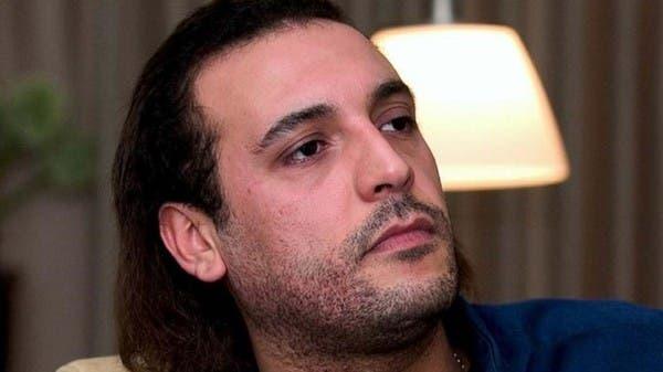 """نجل القذافي يناشد من سجنه.. """"وضعي سيئ"""""""