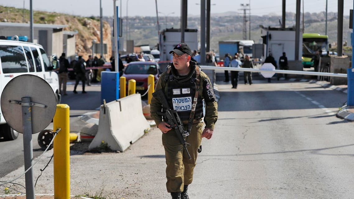 Israeli soldiers stand guard at the al-Zaim checkpoint on the outskirts of east Jerusalem. (AFP)