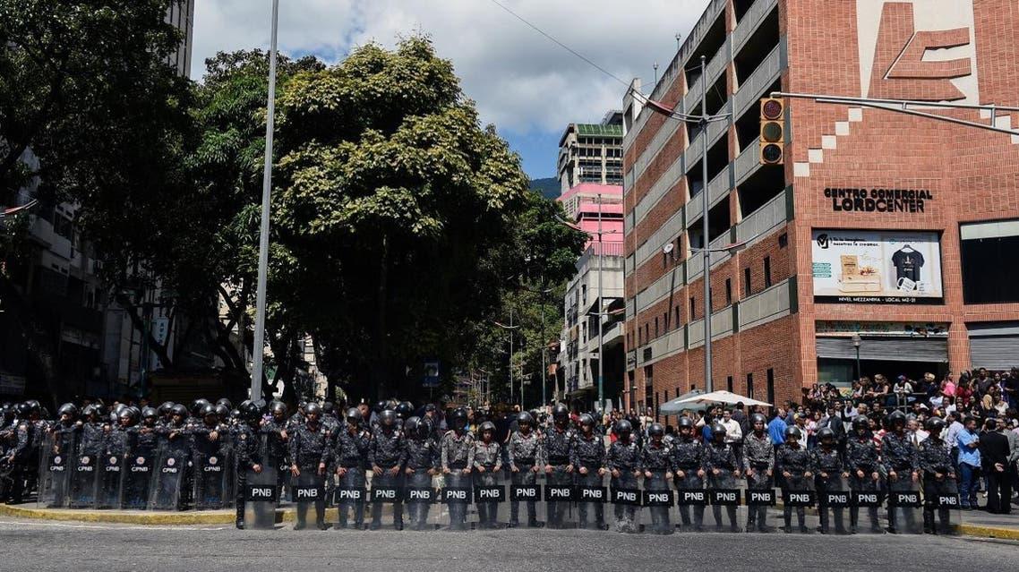 Venezuela police stand guard in anti Maduro protest (AFP)