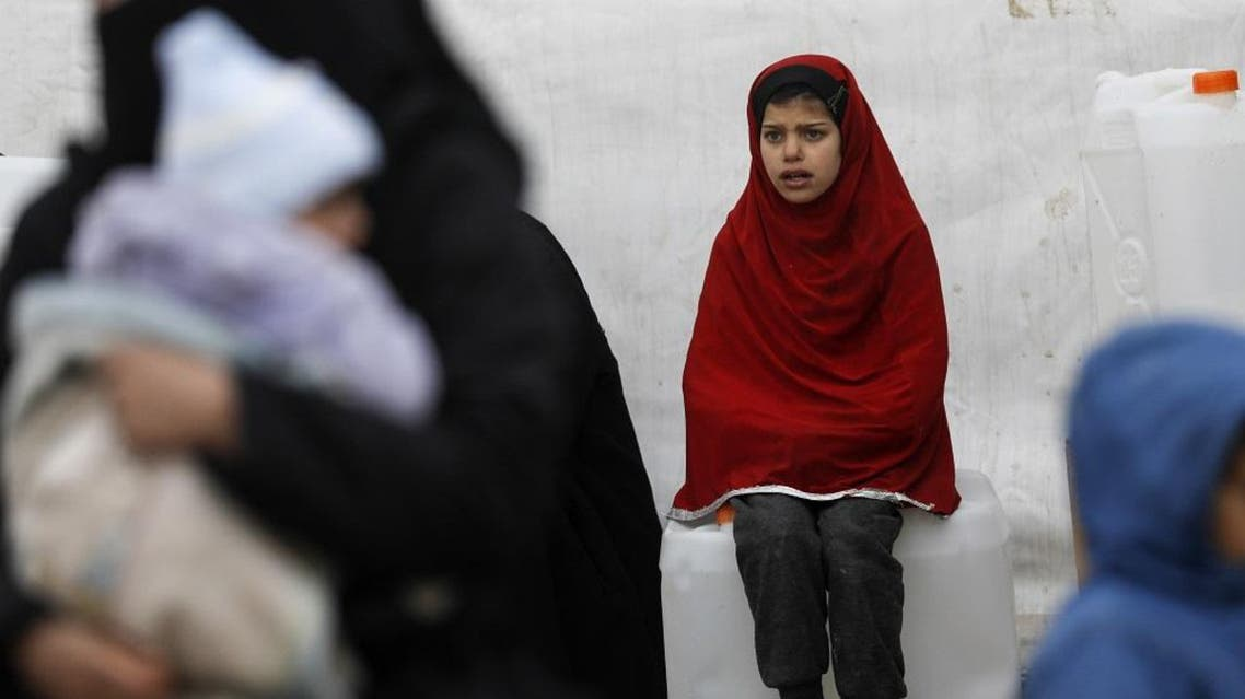 A Syrian girls looks on as aid items to cope with the winter weather are delivered to the al-Hol refugee camp. (File photo: AFP)