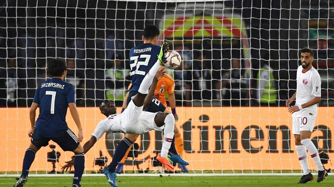 Qatar's forward Almoez Ali, center, scores his sides first goal. (AP)