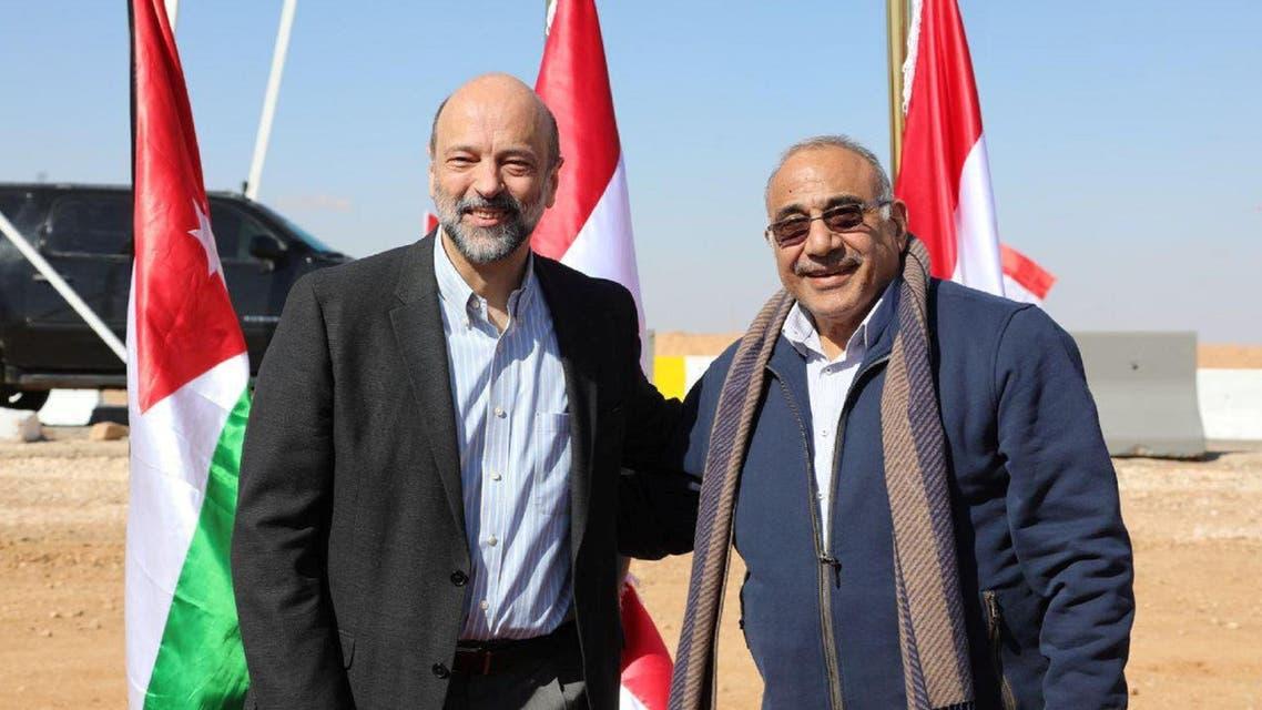 Jordan's Prime Minister Omar al-Razzaz stands with Iraqi Prime Minister Adel Abdul-Mahdi on the Iraqi-Jordanian border, Iraq February 2, 2019. (Reuters)
