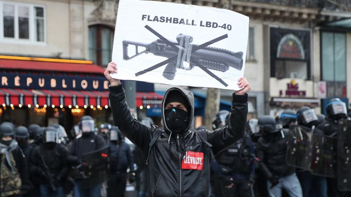 A protester holds up a sign against the use of non-lethal hand-held weapons (LBD40), on the sidelines of a march called by 'Yellow Vest' protesters in Paris on February 2, 2019. (AFP)