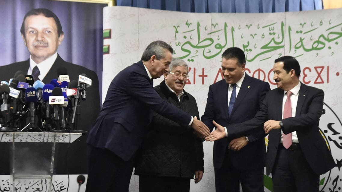 Amara Benyounes, Ahmed Ouyahia, Mouad Bouchareb, and Amar Ghoul, Algerian Ministers and representatives of the president-candidate Abdelaziz Bouteflika, shake hands after a political meeting in the capital Algiers on February 2, 2019. (AFP)