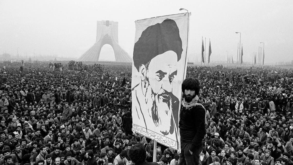 Demonstrators hold up a poster of exiled Muslim leader Ayatollah Ruhollah Khomeini during an anti-shah demonstration in Tehran, Iran on December 10, 1978. (AP)