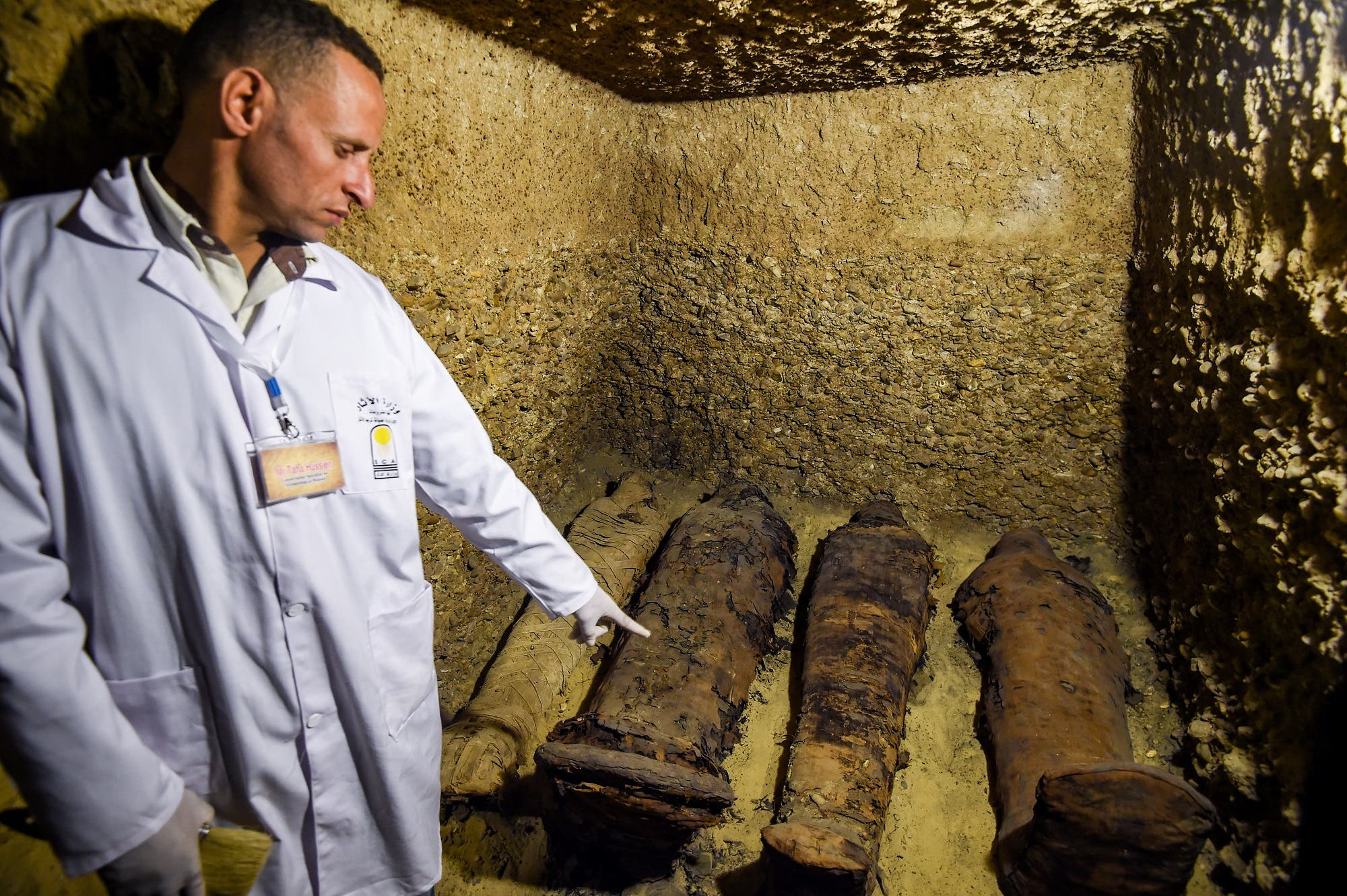 The mummies, 12 of which were of children, were discovered inside four, nine-meter deep burial chambers in the Tuna El-Gebel archaeological site. (AFP)