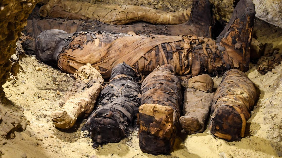 Egyptian archaeologists uncovered a tomb containing 50 mummies dating back to the Ptolemaic era, in Minya, south of Cairo. (AFP)