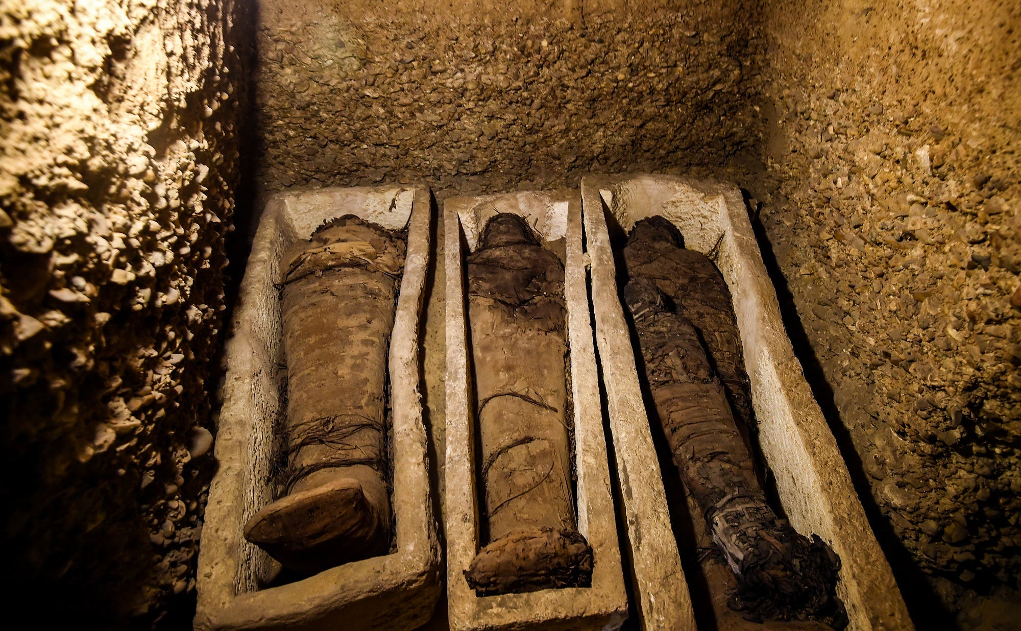 Some of the mummies were found wrapped in linen while others were placed in stone coffins or wooden sarcophagi. (AFP)