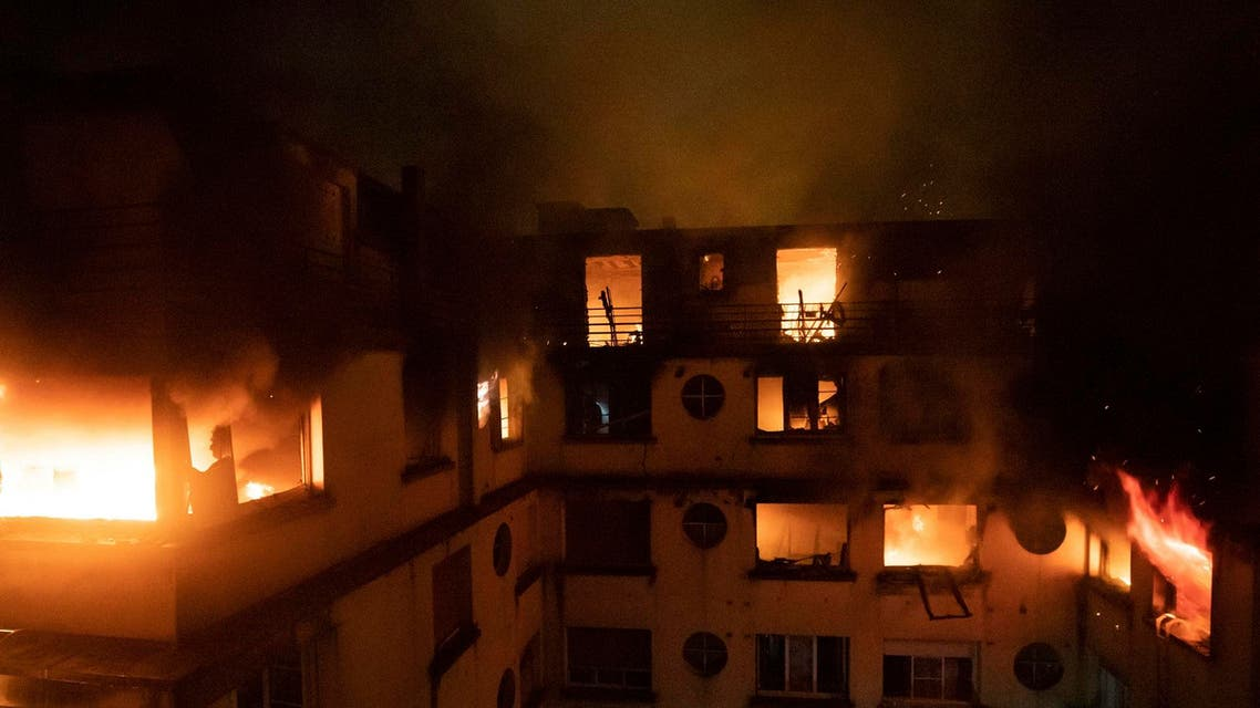 A fire in a Paris apartment building early Tuesday that authorities suspect was an arson attack, killed seven people. (AP)
